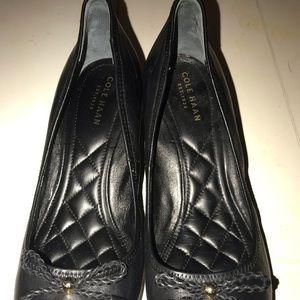 Cole Haan black leather platforms.
